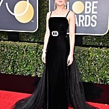Dakota Johnson's Golden Globes Dress Comes With a Big Surprise on the Back