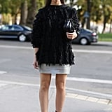 Street glam, courtesy of a fur topper, metallic mini, and a pair of strappy heels.