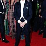 Maggie Gyllenhaal adjusted her dress behind designer Valentino Garavani.