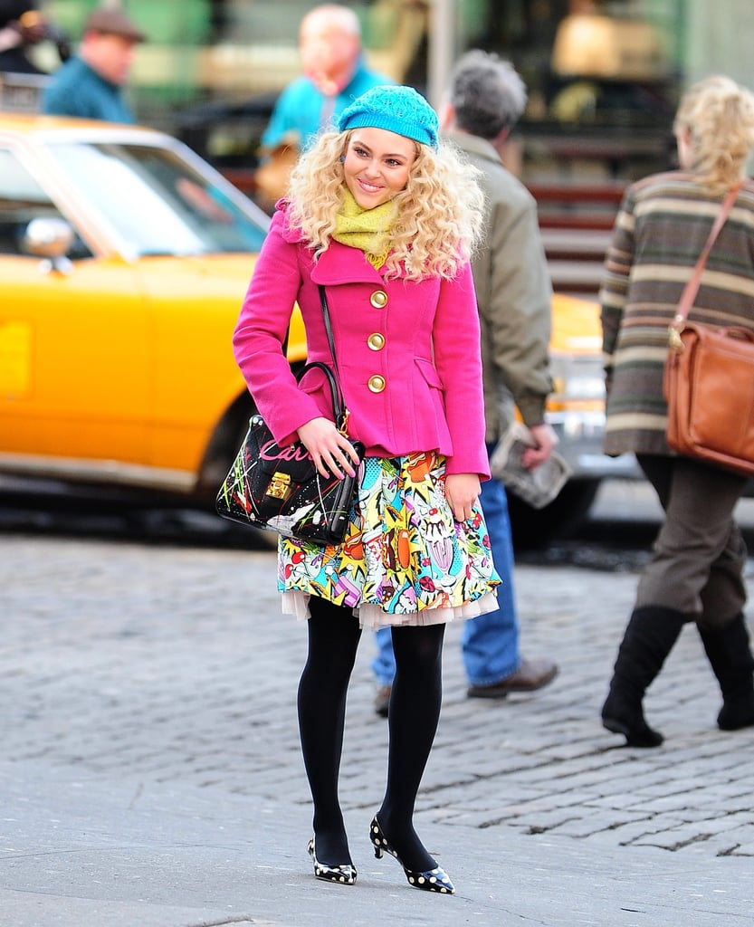 Carrie mixed bold prints and bright colors while cruising around NYC. Although we love her sundae skirt and pop pink jacket, what really caught our eye was her polka-dot Kate Spade pumps ($298).