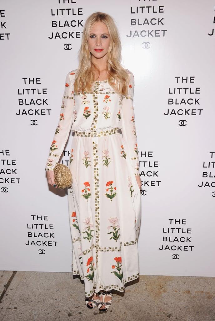 Poppy Delevingne looked Spring-perfect in a floral-print white maxi gown, accented with a beaded gold clutch and a pop of coral lipstick.
