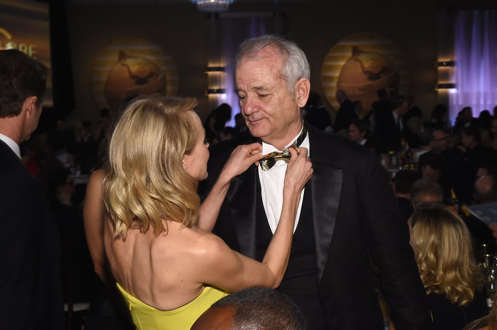 Naomi Watts fixed Bill Murray's bow tie during a commercial break.