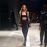 Karlie hit the runway in an embellished blazer and a bare midriff.
