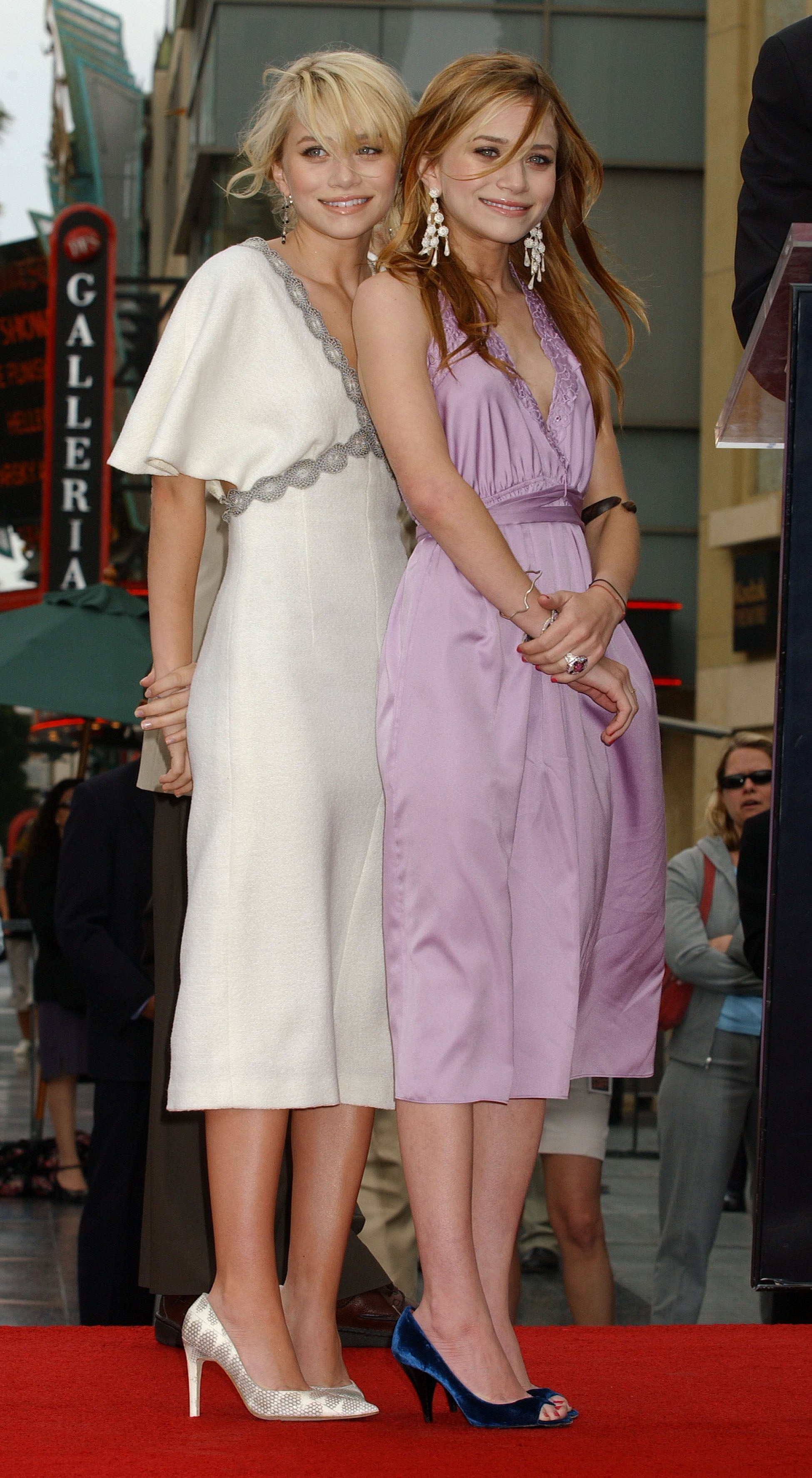 Twinning combo: The honorees looked picture perfect in silky pastel dresses and prim pumps while accepting their star on the Hollywood Walk of Fame in 2003.  Ashley wore a white flutter-sleeve dress with beaded embellishments and snakeskin pumps. Mary-Kate complemented her lilac halter with navy suede peep-toe pumps and chandelier earrings.