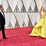 Pictured: Judd Apatow and Leslie Mann
