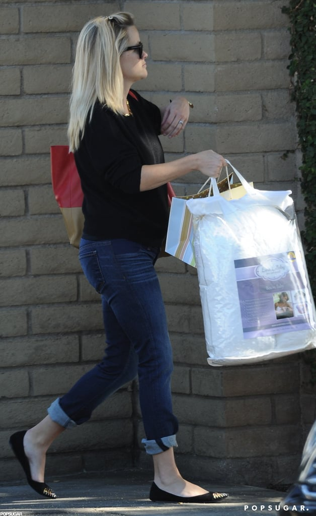 Reese Witherspoon picked up a few items during a shopping trip around Santa Monica yesterday. It was the first time she's been spotted since giving birth to her third child late last month. Reese welcomed Tennessee James, her first baby with husband Jim Toth, on Sept. 27. While Reese has been sticking close to home in the days following Tennessee's birth, Jim has been handling dad duty to Reese's older kids, Ava and Deacon. Last week, he took them to Deacon's soccer game in LA. Work hasn't been far from Reese's mind, though, since she reportedly has plans to executive produce a version of Great Expectations for the small screen.