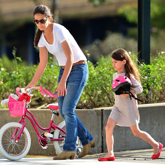 Suri Cruise Riding a Bike (Video)