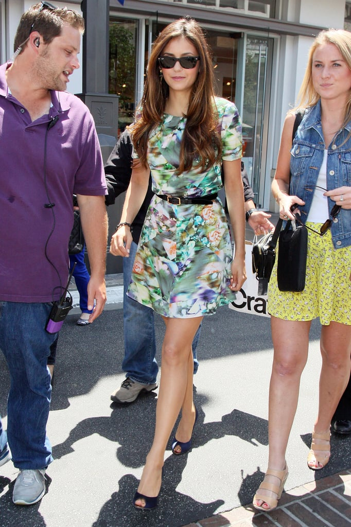 Nina Dobrev looked ready for Spring in a floral print dress.