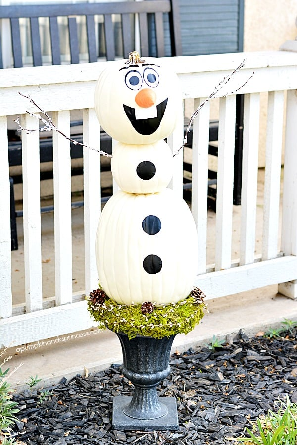 You don't need a frost for this snowman to make an appearance. DIY pumpkin Olaf springs forth from an urn (in lieu of a traditional topiary) to greet trick-or-treaters.