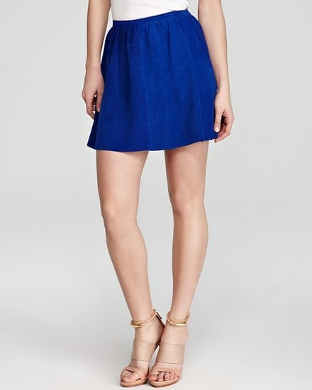 If you veer toward feminine styles, then add this Patterson J. Kincaid cobalt suede skirt ($298) to your mix. Then punch it up even more with a bright yellow tank.
