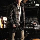 Tom Cruise in a winter jacket while filming One Shot.