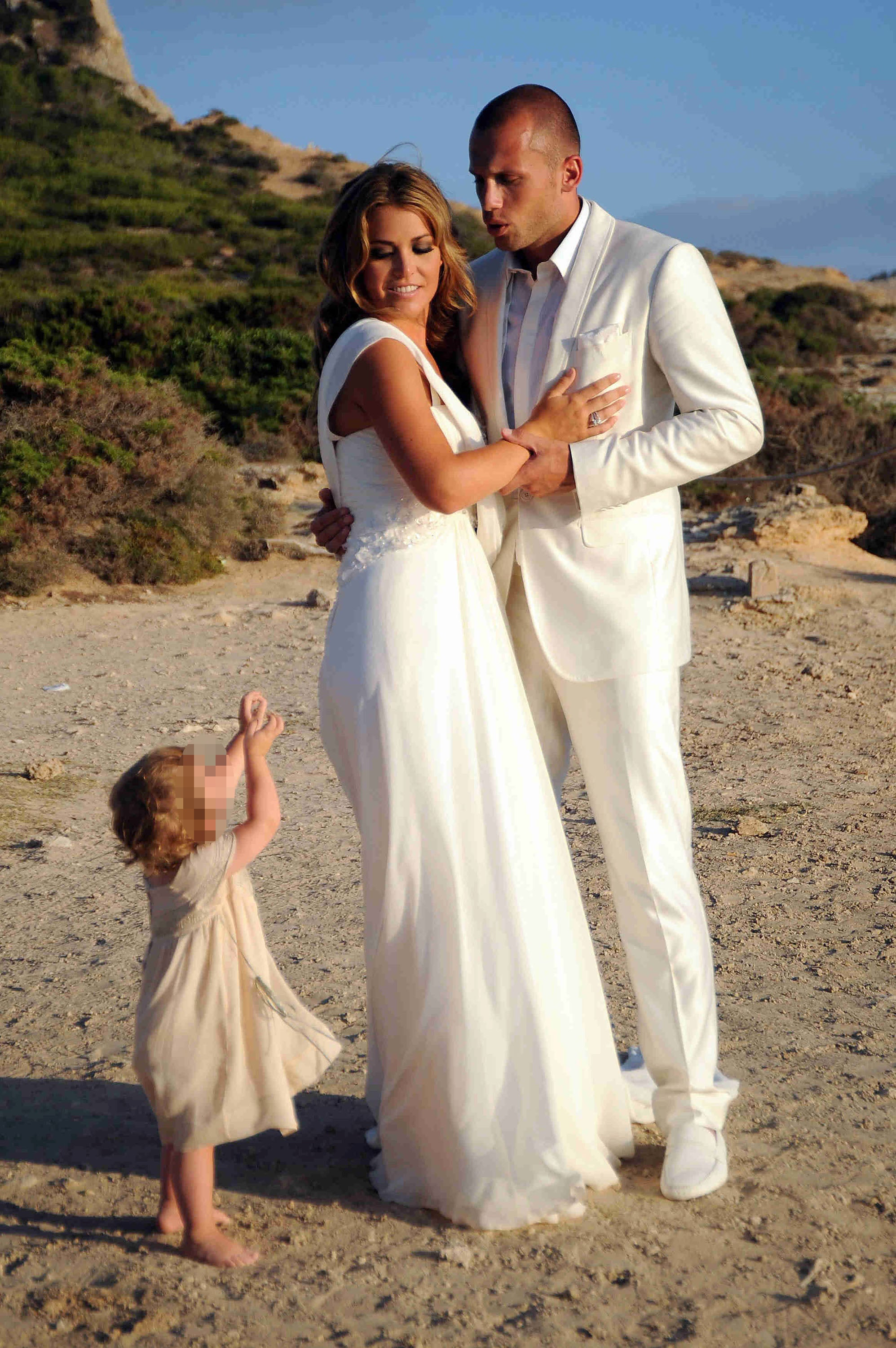 Family photo of the football player, married to Charlotte-Sophie Heitinga, famous for Atlético Madrid & Ajax.