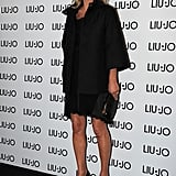 Kate Moss stepped out for the Liu Jo store opening during Milan Fashion Week, and kept it chic in a black slip dress and a classic coat.