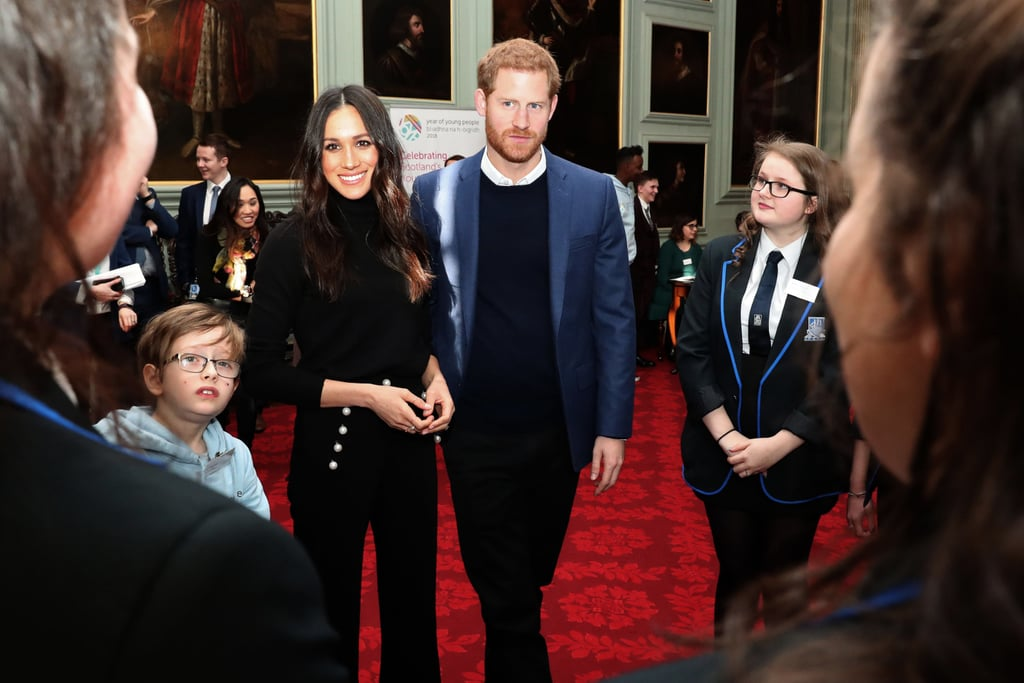 During a visit in Edinburgh, Scotland, Meghan wore a jet-black outfit under a beautiful tartan Burberry coat.