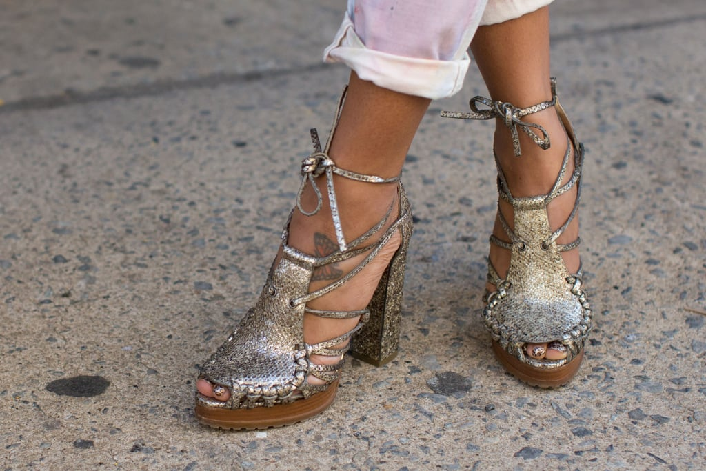 We spied a unique pair of lace-up metallic heels taking the streets outside the tent.
