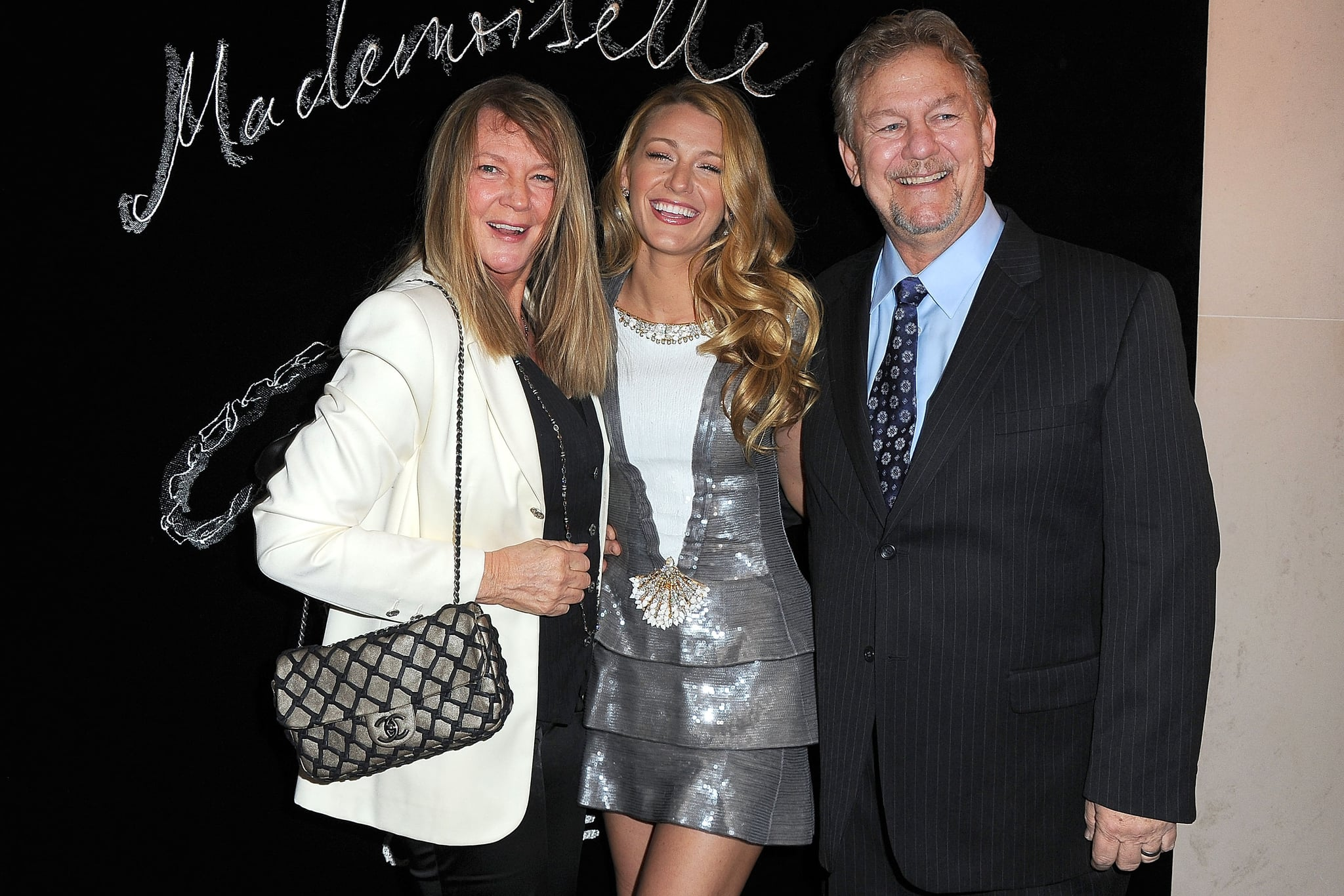With Elaine and Ernie Lively — who we're guessing have to be her proud parents. Cute!