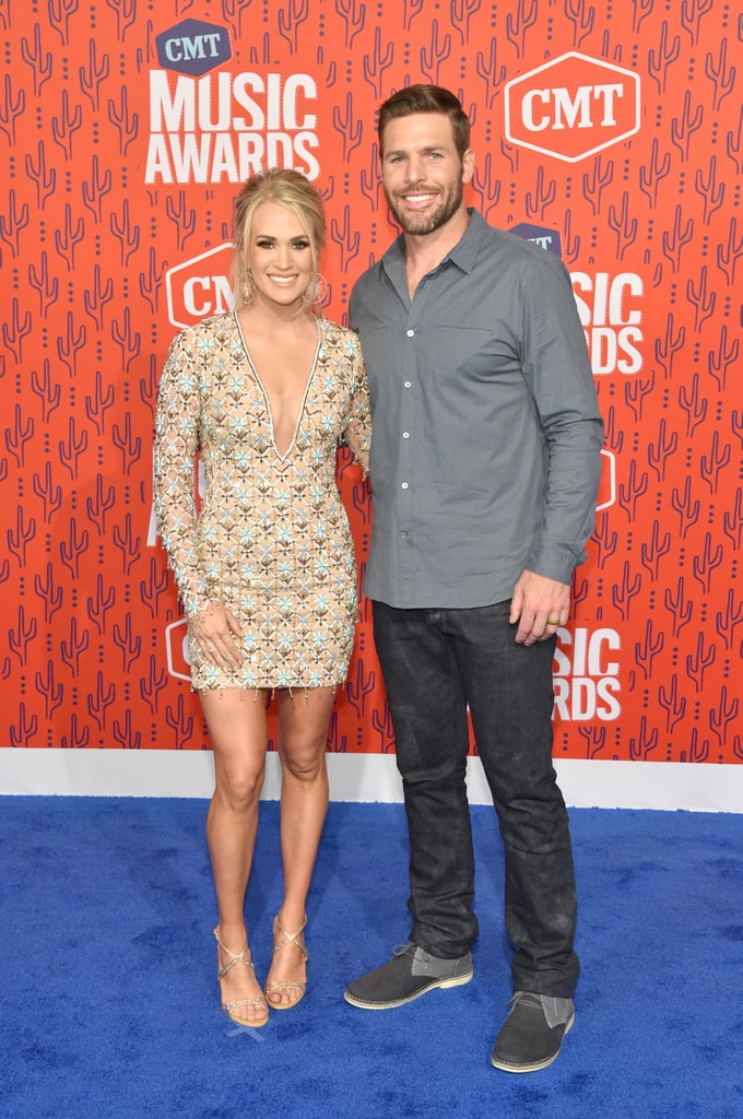 "Carrie Underwood knows the recipe for a dazzling red carpet outfit. The 36-year-old singer stepped out for the CMT Awards on June 5 with husband Mike Fisher, and chose a pastel Michael Cinco dress for the occasion. The jewel-encrusted minidress featured an eye-catching plunging neckline, along with delicate embroidery and beading throughout — perfect for a record-setting award-winner, like Carrie. She paired the outfit with sparkling gold Diamanté sandals, dangling Djula starburst earrings, and of course, her ginormous engagement ring. Check out even more photos of her ensemble from all angles, and then check out her performance of ""Southbound"" from the show."