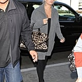 Jessica Simpson carried a large animal print tote.