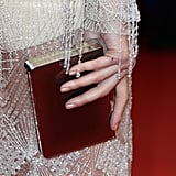 Paz Vega complemented her silver gown with a sleek box clutch.