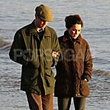 Kate Middleton and Prince William wore woodsy clothing for a Winter's walk on the beach.