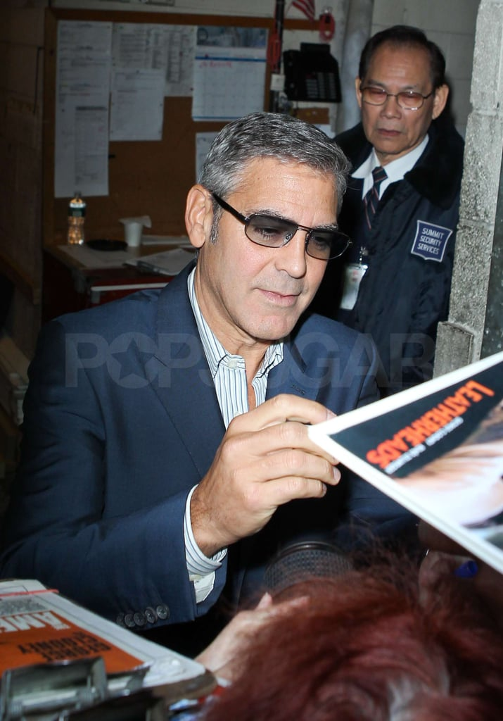 George Clooney autographed his own movie posters.