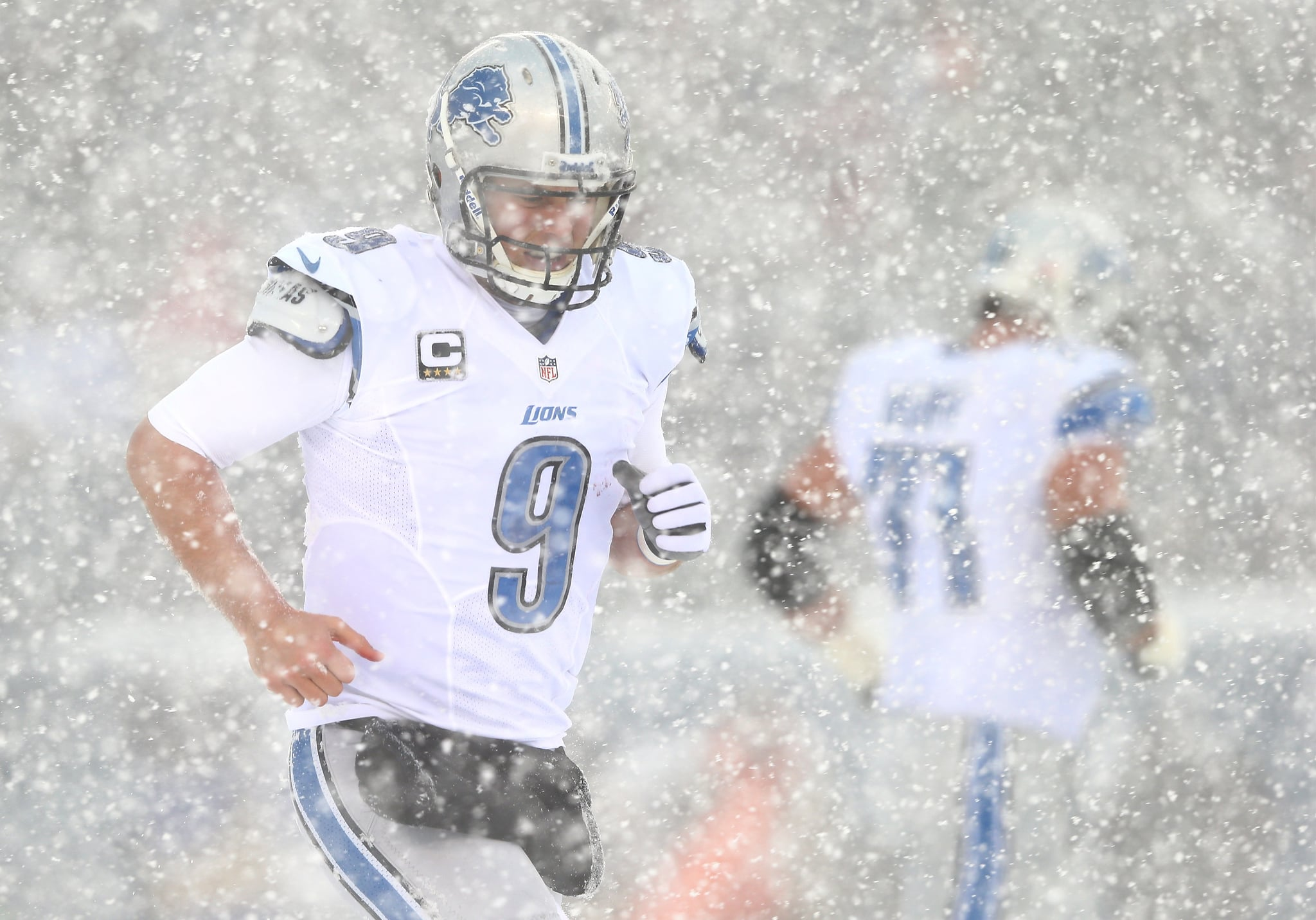 The Detroit Lions' Matthew Stafford ran through the snow during his team's game against the Philadelphia Eagles.