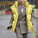 Black and white puffer vests are plentiful for Fall, but go the other route and choose one in a bolder color like neon yellow. This street style star wore her bomber vest opened with a blazer and collared shirt, which you can easily recreate.