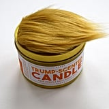 The Candle Features a Cluster of Fake Hair on Top