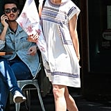 Katie Holmes enjoyed a sunny day out in NYC wearing a printed dress with navy Superga sneakers.