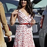 Lea Michele put a red belt around her floral-print dress.