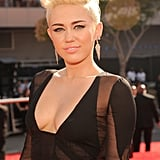 Miley Cyrus sported dangling earrings.