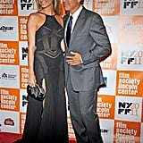 George Clooney lead Stacy Keibler into the premiere of The Descendants at the New York Film Festival.