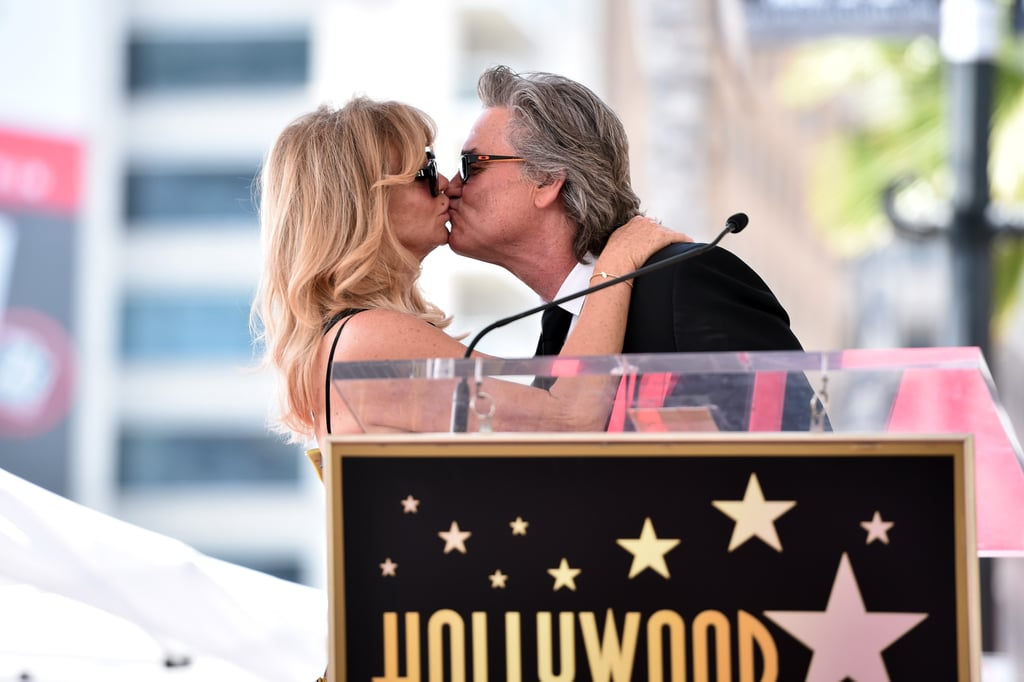 "Kurt Russell and Goldie Hawn brought their star power to the Hollywood Walk of Fame in LA on Thursday. The longtime couple was honored for their extensive careers by Reese Witherspoon, Quentin Tarantino, and their daughter, Kate Hudson, as they received stars on the legendary memorial walk and shared a sweet kiss before taking turns to speak at the podium. This week, Goldie's Snatched costar Amy Schumer shared a heart-melting video of her father being brought to tears while meeting Goldie, who is the ""love of his life."" The movie comes out on Mother's Day, and Kurt's new film, Guardians of the Galaxy 2 is released on Friday."