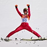 Polish ski jumper Kamil Stoch put his hands up after winning the gold medal in the men's normal hill individual final.