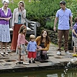 Princess Mary smiled with her kids at the Danish royal family's annual Summer photo call at Grasten Slot in Denmark in July 2012.
