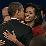 Michelle got a kiss on the cheek from Barack following a town hall debate for the 2008 campaign.