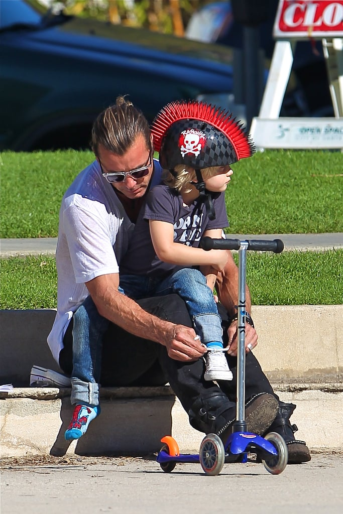 Gavin Rossdale tied Zuma Rossdale's shoe at the park.