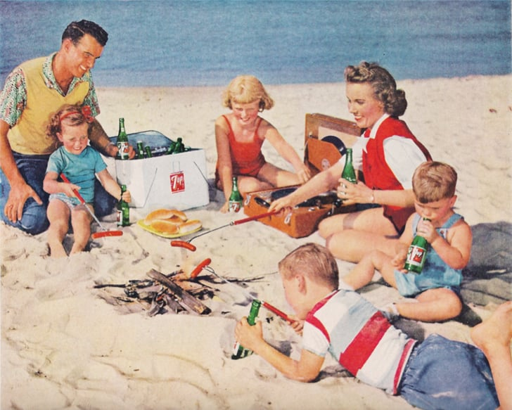 Just An All American Family Enjoying Dogs On The Beach