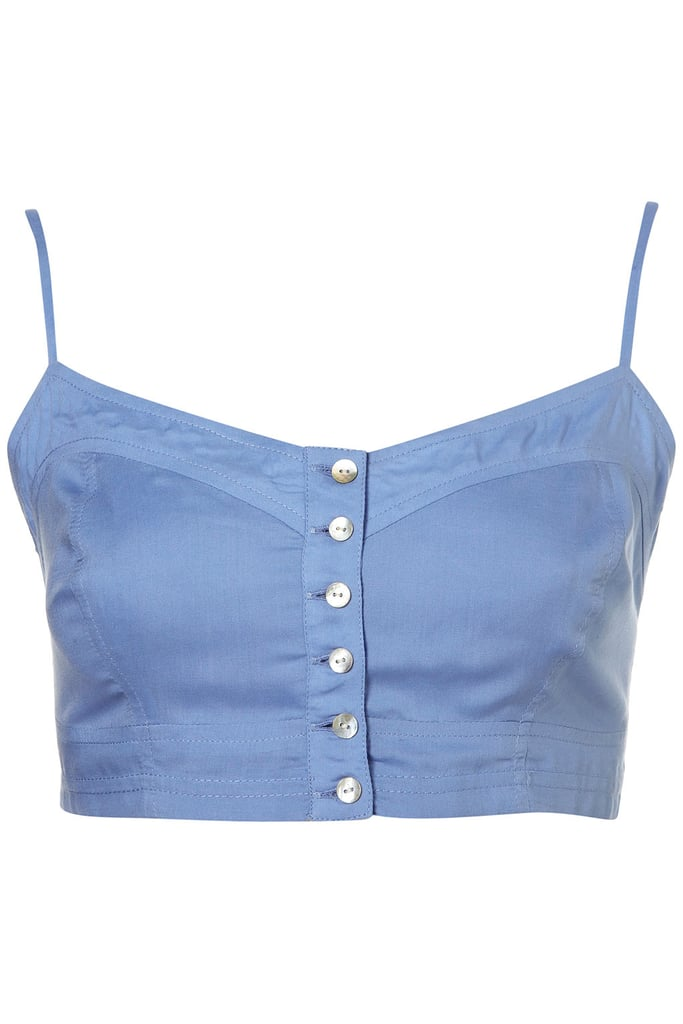 Layer this sweet blue bralette under a sheer white blouse or wear as a crop top with high-waisted shorts. Topshop Soft Blue Button Up Bralet ($45)