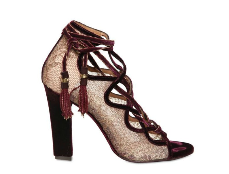First thought that comes to mind? This is what a sultry flamenco dancer would wear. Clearly, we want a pair, too. Salvatore Ferragamo Tokara Lace Velvet Open-Toe Pumps ($1,336)