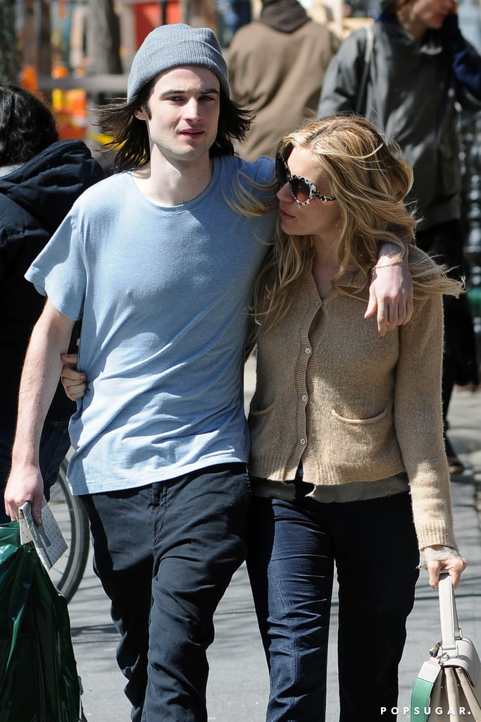 Sienna Miller kept close to her fiancé, Tom Sturridge.