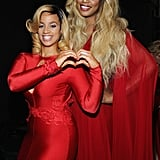 Orange Is the New Black stars Laverne Cox and Dascha Polanco posed backstage before walking the runway at the Go Red For Women Red Dress Collection show.