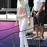 While boarding a yacht in Cannes, Karolína Kurková gave her white denim a preppy spin with white loafers and a colorblocked sweater.