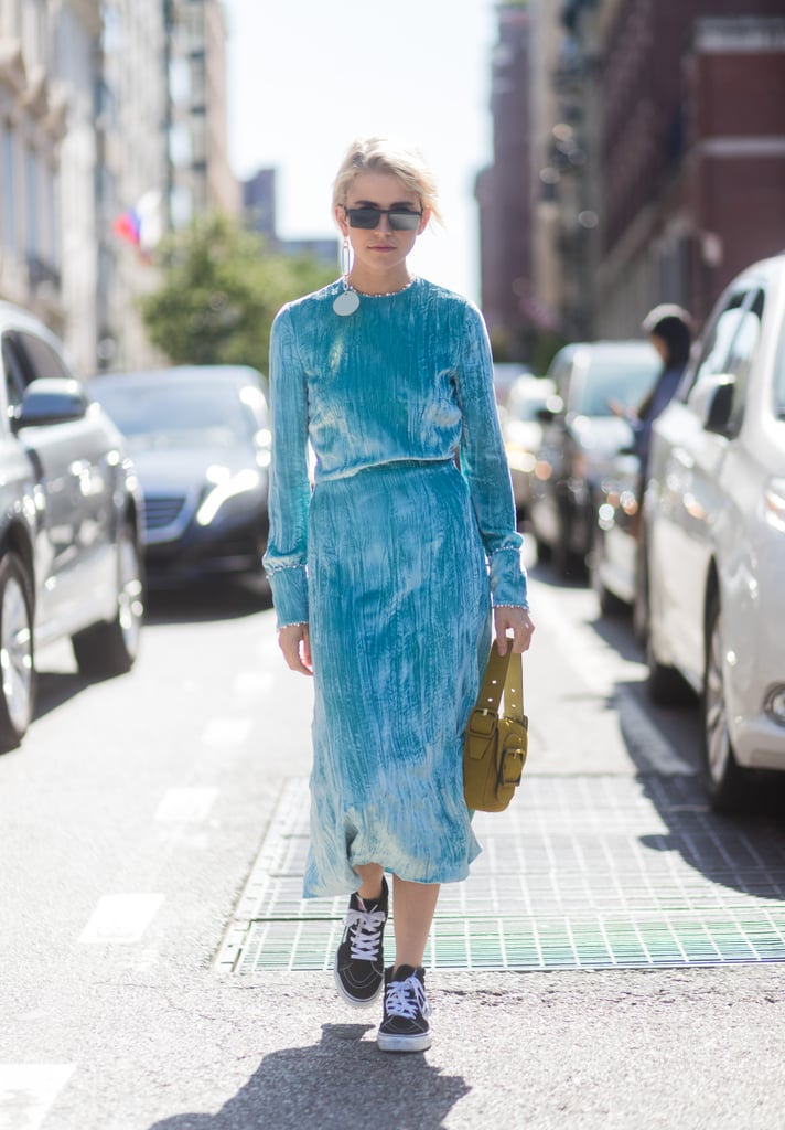 With a Long-Sleeve Velvet Dress and Contrasting Purse