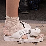 A crisscross rubber sandal that's the product of a collaboration with Ugg.