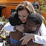 She hugged locals while on a visit to Soweto.