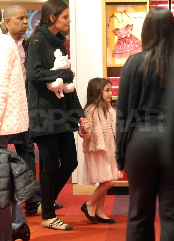 Katie Holmes and Suri Cruise ventured out in NYC last night to pick up a present at American Girl Place. It was a mother-daughter evening after a busy day for Katie that included a stop by Good Morning America to chat about her new movie Jack and Jill, which is out on Friday. Katie also hinted at a Dawson's Creek reunion, but no plans for that are apparently in place just yet. While Katie's talking up her Adam Sandler comedy, her husband Tom Cruise is off working on One Shot in Pennsylvania. It will be Tom's turn to step into the spotlight soon, though, when Mission Impossible: Ghost Protocol hits theaters next month.