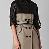 The sharp leather detailing gives this an edgier vibe that would lend that cool-girl effect to anything you wear with it.  Doo.ri Trench Coat with Belt and Cropped Overlay ($1,795)