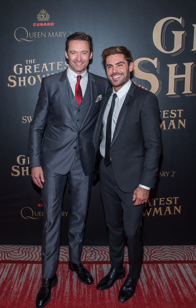 The cast of The Greatest Showman was dressed to the nines at the NYC movie premiere on Friday night. Hugh Jackman, Zendaya, and Zac Efron walked the red carpet event ahead of the release of the musical drama, which hits theaters on Christmas day. While Zendaya almost stole the show with her gorgeous black and red gown, it was Hugh and Zac's adorable bromance that was enough to make our hearts melt. Keep reading to see all of the fun photos from the epic premiere ahead.