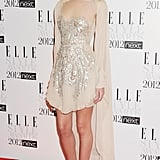Rosie sparkled in this ethereal Antonio Berardi dress at the Elle Style Awards in 2012. The model paired her sheer, caped dress with gold Sergio Rossi sandals.